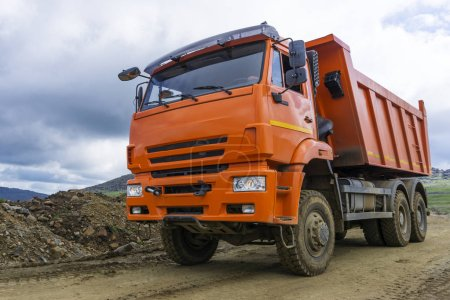Dump truck rides on the mountain road under construction