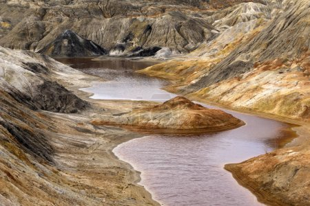 lake with red water with dissolved pyrite salts in the desert landscape of a spent quarr
