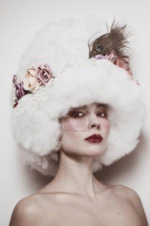 Vintage style portrait of beautiful woman in fancy wig