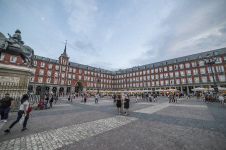 MADRID, SPAIN - JULY 21, 2018: Plaza Mayor with statue of King Philips III in Madrid. Madrid is a popular tourism destination with average about of 4 million estimated annual visitors.