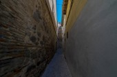 narrow streets of the Spanish city of Toledo, a medieval city with cobblestone and mud streets