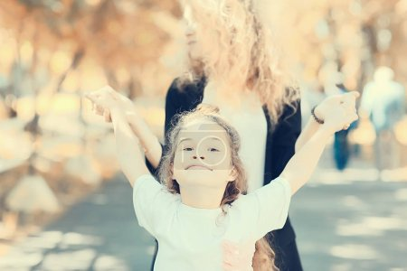 Photo for Concept of family happiness, beautiful mother and daughter in park - Royalty Free Image