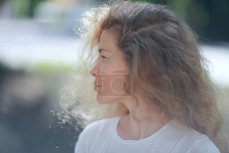 Photo for Romantic portrait of young beautiful woman with curly hair - Royalty Free Image