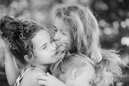 concept of family happiness, beautiful mother and daughters in park