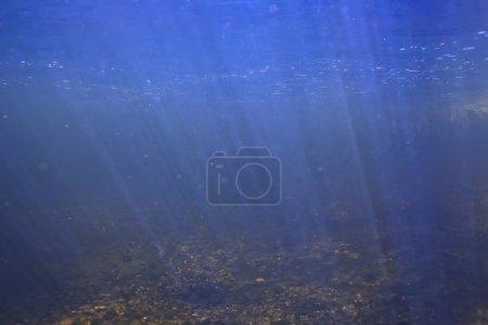 sunbeams underwater photo / texture underwater landscape with sun rays, blue water sun in the ocean