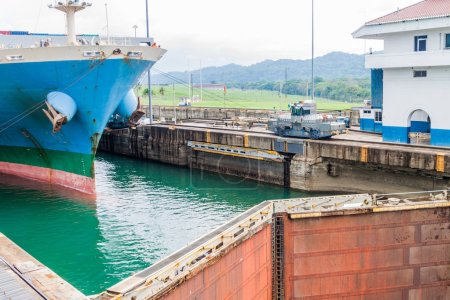 Ship is  passing through Gatun Locks, part of Panama Canal.
