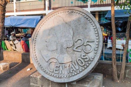 SANTIAGO ATITLAN, GUATEMALA - MARCH 23, 2016: Monument of 25 centavos coin. The bust shows native woman in traditonal garment of Santiago Atitlan village.