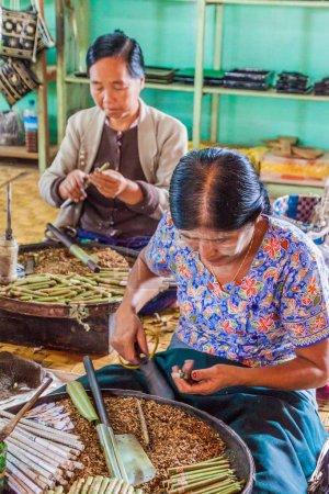 INLE, MYANMAR - NOVEMBER 28, 2016: Workers of a cigar workshop at Inle lake, Myanmar