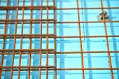 Floor thermal insulation and Wire mesh steel Rebars for reinforced concrete.Floor heating insulation, warm house, eco friendly insulation. Steel reinforcement bar texture in construction site. Iron rods.