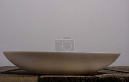 Top view of blank white dish and white tablecloth ...