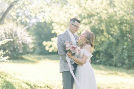 Wedding couple in the Park hugging and kissing. Ph...