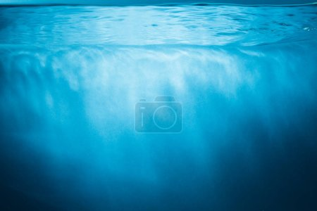 Photo for Abstract blue water background with sunbeams - Royalty Free Image