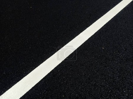 Road traffic paint on the asphalt surface And to e...