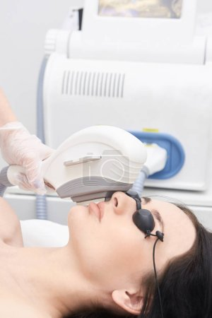 Medical procedure. Hair removal on the face. Laser hair removal. Bright skin.