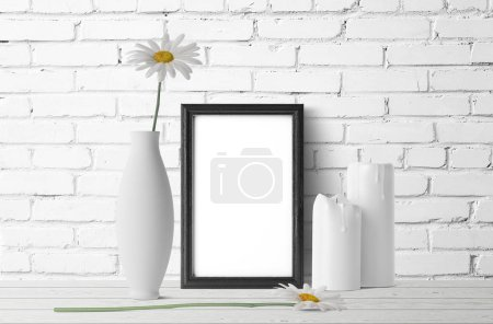 blank frame with chamomile flowers and books