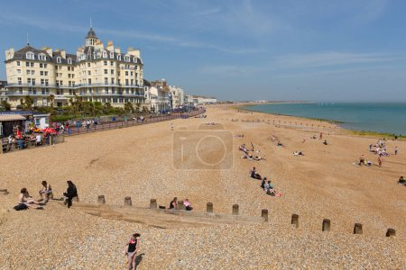 Photo for EASTBOURNE, EAST SUSSEX, ENGLAND, UK-APRIL 22nd 2018: The glorious spell on spring weather attracted visitors to the beach at Eastbourne, East Sussex, on Sunday 22nd April 2018 - Royalty Free Image