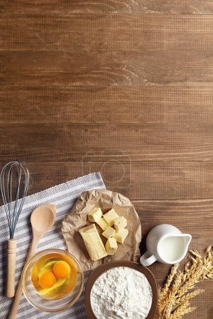 Photo for Baking Ingredients On Wooden Table. Variety Of Food Products For Dough Preparation Still Life Flat Lay. High Resolution - Royalty Free Image