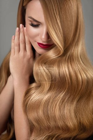 Photo for Hair Beauty. Beautiful Woman With Fashion Makeup And Curly Long Blonde Hair. Portrait Of Glamour Girl With Wavy Hairstyle. High Resolution - Royalty Free Image