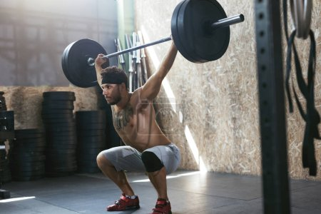 Photo for Sportsman Training With Barbell Row At Crossfit Gym. Athletic Man At Workout At Fitness Club. High Resolution - Royalty Free Image