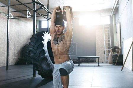 Photo for Gym. Crossfit Man Training With Dumbbells At Fitness Club. Male Athlete Workout With Weights At Gym. High Resolution - Royalty Free Image