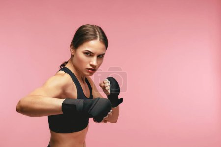 Photo for Female Boxer. Sportswoman Training In Boxing Bandages, Posing On Pink Background. High Resolution - Royalty Free Image
