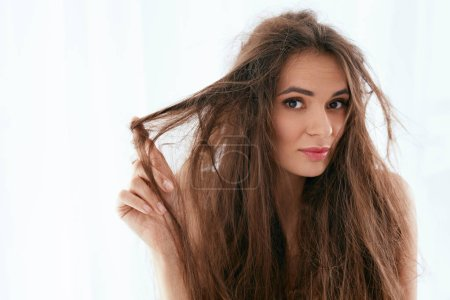 Hair Problem. Woman With Dry And Damaged Long Hair...