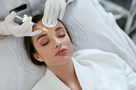 Photo for Beauty Injections. Woman On Rejuvenation Procedure In Clinic, Injection Against Forehead Wrinkles. High Resolution - Royalty Free Image