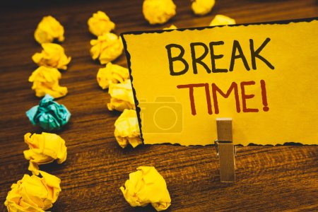 Photo for Handwriting texts Break Time Motivational Call. Concept meaning Moment to stop working Get relax PauseClothespin holding Yellow paper ideas crumpled papers wooden background - Royalty Free Image