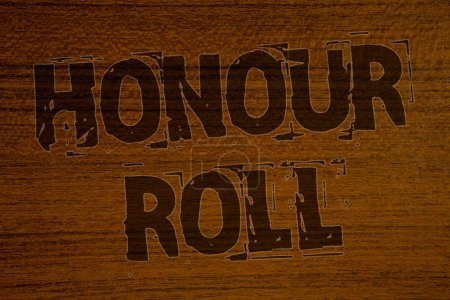 Photo for Conceptual hand writing showing Honour Roll. Business photo showcasing List of students who have earned grades above a specific averageBold brown letters words ideas on wooden background - Royalty Free Image