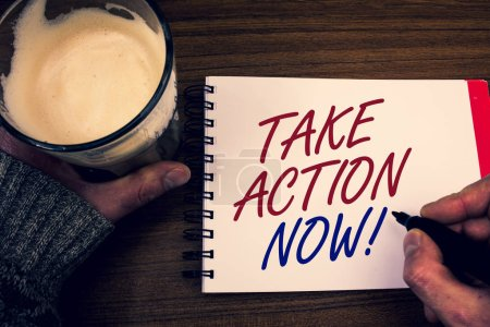 Word writing text Take Action Now Motivational Call. Business concept for Urgent Move Start Promptly Immediate Begin Words notepad hands jumper holding open pen coffe glass desk sketch quick