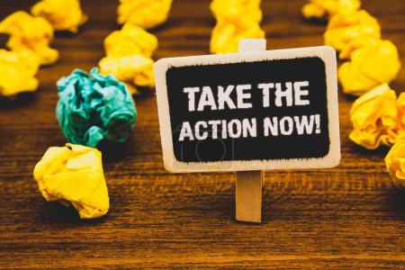 Text sign showing Take The Action Now Motivational Call. Conceptual photo Act Start Promptly Immediate Instantly Blackboard with letters wooden floor blurry yellow paper lumps green lob