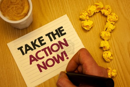 Conceptual hand writing showing Take The Action Now Motivational Call. Business photo showcasing Act Start Promptly Immediate Instantly Wooden desktop hand hold marker page coffee question mark