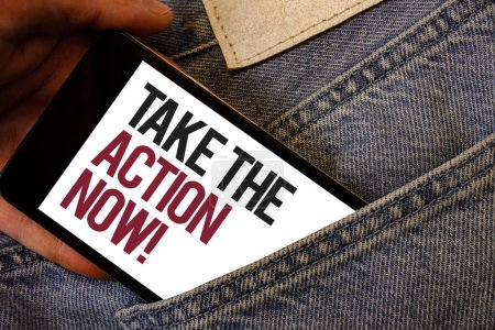 Writing note showing  Take The Action Now Motivational Call. Business photo showcasing Act Start Promptly Immediate Instantly Human hand bring out cell phone with colorful text jeans back pocket