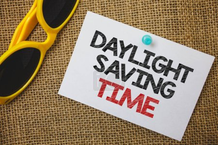 Photo for Writing note showing  Daylight Sayving Time. Business photo showcasing advancing clocks during summer to save electricity Sunglass paper wonderful white background lovely message idea memories - Royalty Free Image