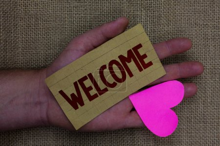Writing note showing Welcome. Business photo showcasing Warm salutation acknowledgement for someone amiable loved thanked Wood art work memories lovely love thoughts mat memories hart shadow