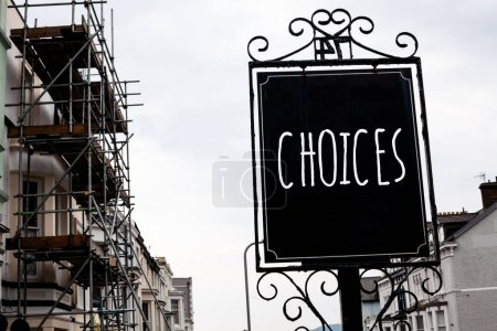 Word writing text Choices. Business concept for Preference Discretion Inclination Distinguish Options Selection Vintage black board sky old city vintage antique ideas message scaffolding
