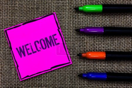 Writing note showing Welcome. Business photo showcasing Warm salutation acknowledgement for someone amiable loved thanked Marker pens art pink paper nice mat love thought black shadow memories