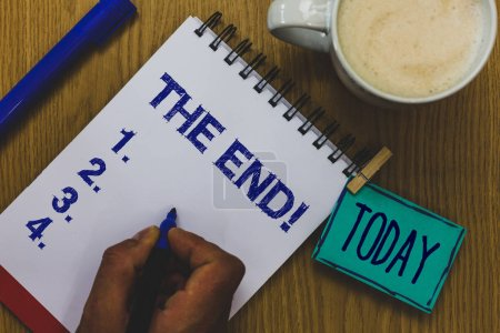 Handwriting text The End Motivational Call. Concept meaning Conclusion of time for something ending of life Mug coffee paper marker pens nice art clip paperclip daily wordlists