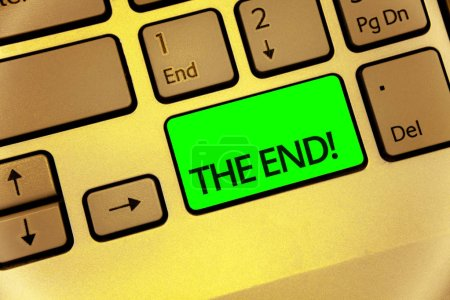 Text sign showing The End Motivational Call. Conceptual photo Conclusion of time for something ending of life Keyboard key laptop creative computer brown keypad idea notebook netbook