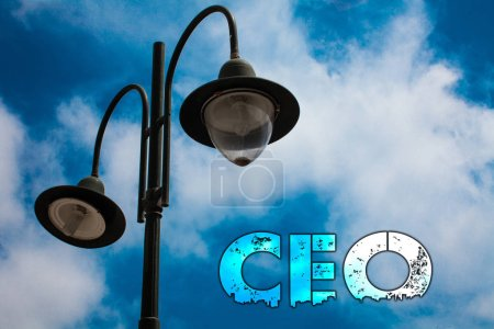 Word writing text Ceo. Business concept for Chief Executive Officer Head Boss Chairperson Chairman Controller Light post blue cloudy clouds sky ideas message enlighten reflections
