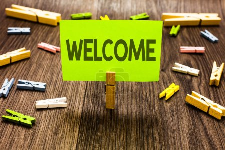 Writing note showing Welcome. Business photo showcasing Warm salutation acknowledgement for someone amiable loved thanked Clips art board creative ideas paper paperclip holding wood shadow