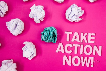 Text sign showing Take Action Now Motivational Call. Conceptual photo Urgent Move Start Promptly Immediate Begin Text Words pink background crumbled paper notes white blue stress angry
