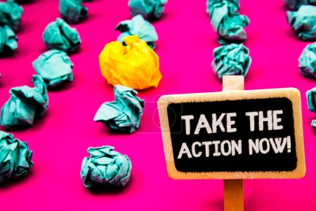 Conceptual hand writing showing Take The Action Now Motivational Call. Business photo text Act Start Promptly Immediate Instantly Blackboard with white letter pink base much green paper lobs