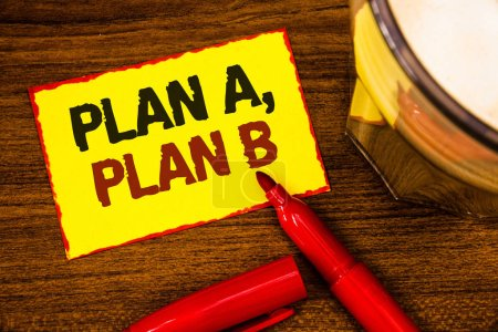 Photo for Writing note showing  Plan A, Plan B. Business photo showcasing Strategic Solutions Ideas Paths to follow to choose from Words yellow paper note red border open marker cap coffee glass desk - Royalty Free Image