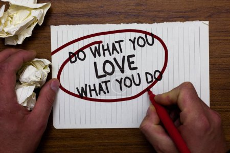 Text sign showing Do What You Love What You Do. Conceptual photo Make things that motivate yourself Passion Hand hold paper lob and red pen red circled black words on white paper