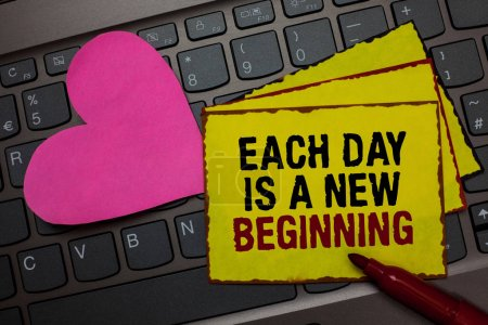 Photo for Writing note showing Each Day Is A New Beginning. Business photo showcasing Every morning you can start again Inspiration Red bordered yellow written paper pinch with love on computer keybaord - Royalty Free Image