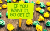 Handwriting text If You Want It, Go Get It.. Concept meaning Make actions to accomplish your goals wishes Paperclip retain written words yellow paper paper lobs laid on wooden floor