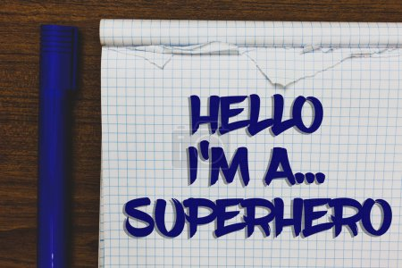 Writing note showing Hello I am A ... Superhero. Business photo showcasing Special powers Cartoon character Customs strenght Written white notepad on grey wooden background beside blue marker