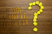 Word writing text If You Want It, Go Get It.. Business concept for Make actions to accomplish your goals wishes Wooden floor with some letters yellow paper lumps formed question mark
