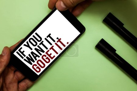 Photo for Text sign showing If You Want It, Go Get It. Conceptual photo Make actions to accomplish your goals wishes Man's hand hold phone with black and red words near two black marker - Royalty Free Image